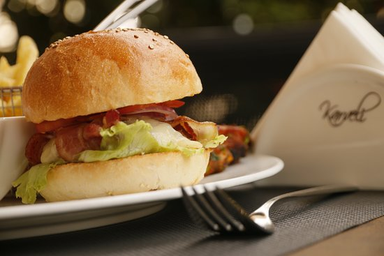 Karveli Restaurant: Karvelicious Burger served with Fries.