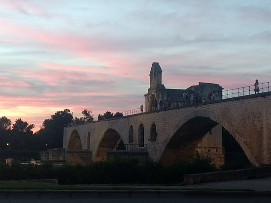 The nocturnal owl of the Pope: Sant Benezet bridge in Avignon at sunset.