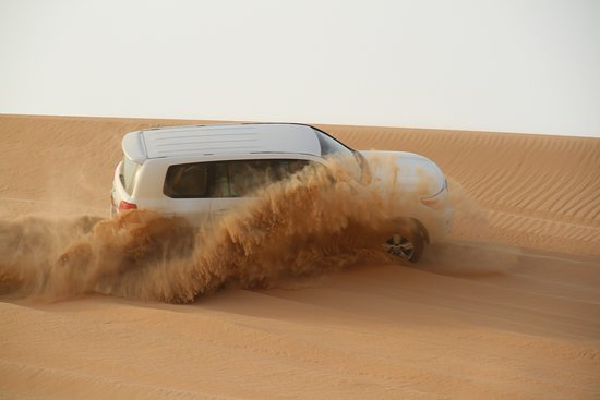 Evening Desert Safari With BBQ Dinner, Henna Painting, Camel Ride and Belly Dance: Dune bash