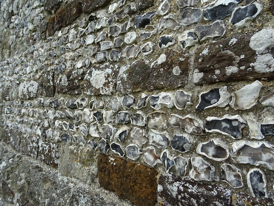Knowlton Church and Earthworks: flint wall of church