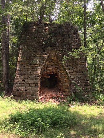 White, GA: 1850's iron ore furnace located 100 yards from Stamp Creek which is a designated trout stream .