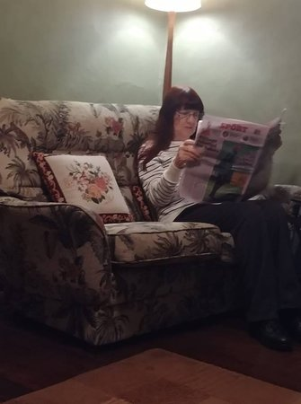 Oatlands, Australia: Reading the paper in the lounge in front of an open fire