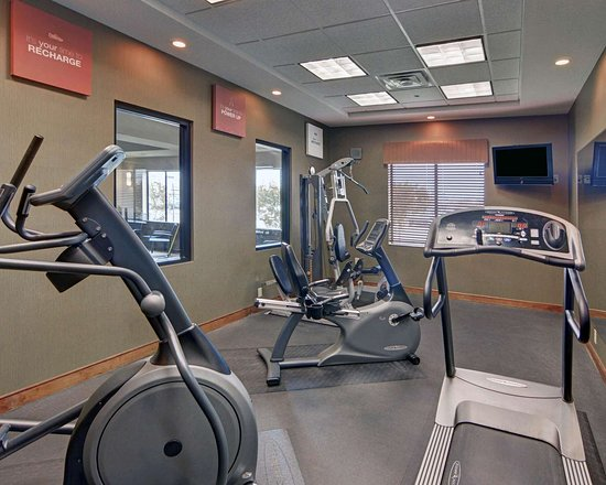 Richland Hills, TX: Exercise room with cardio equipment and weights