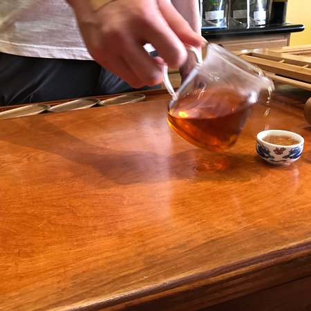Vital Tea Leaf: Teamaster explains and makes different teas for us. Tea cups and pitcher with special plastic in