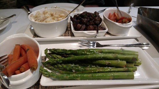 Spencer's for Steaks and Chops: Sides: Crab and mac, mushrooms, candied carrots and asparagus. Plenty for two people.