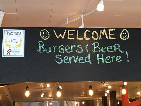 Front Porch Grill House: Sign above bar encouraging patrons to belly up!