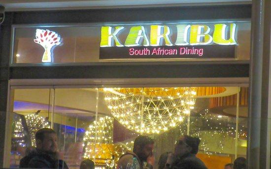 Karibu: Sign at night.