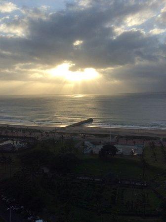 Southern Sun Elangeni & Maharani: Indian ocea n sunrise from our room.
