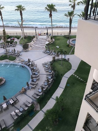 View from the patio deck of swimming pool, terrace and beach