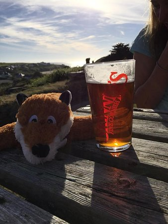 Porthcothan, UK: The view from the terrace with a pint of Betty's