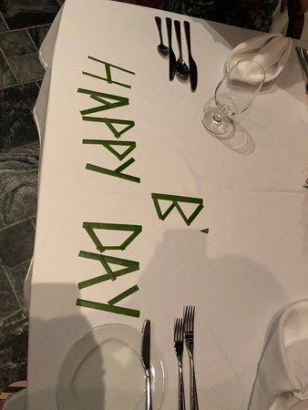 JA Manafaru: birthday message on dining table at ocean grill