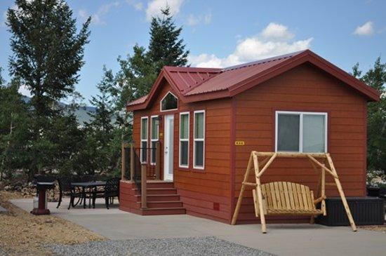 Denver West / Central City KOA: Deluxe Cabin, sleeps 6. Includes linens, a/c, fire-pit, fridge, full bath, t.v., grill, & much m