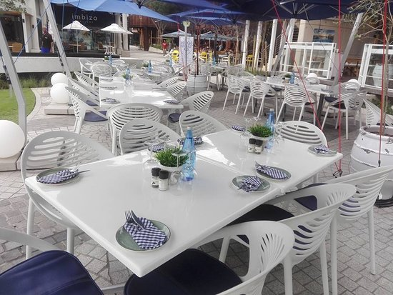 Relaxed casual outdoor seating at Mythos Ballito