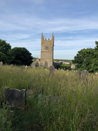 Perranuthnoe, UK : The Church tower through the living graveyard.