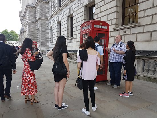 London Top Sights Tours: Tour group being told what phone booths are really used for nowadays...