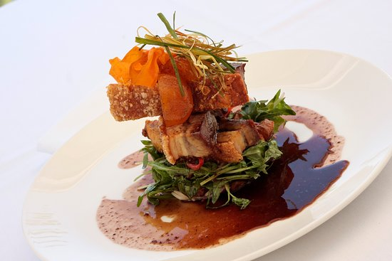 Tides Waterfront Dining: Roasted pork belly, rocket, mustard fruits,