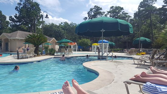 Island Links Resort: same pool with large umbrella covering section of pool for shade.