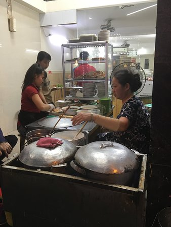 Hanoi Walking Foodie Tour by night: Cooking at work, these ladies are so efficient & quick :)