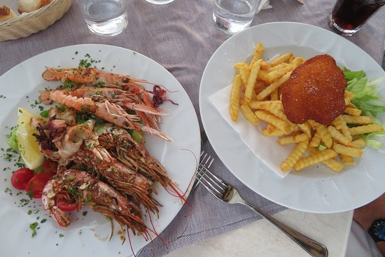 Ristorante Salus: Grilled seafood; breaded pork on french fries