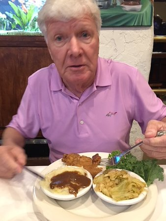 Southern Kitchen: Peter eating smothered pork chops