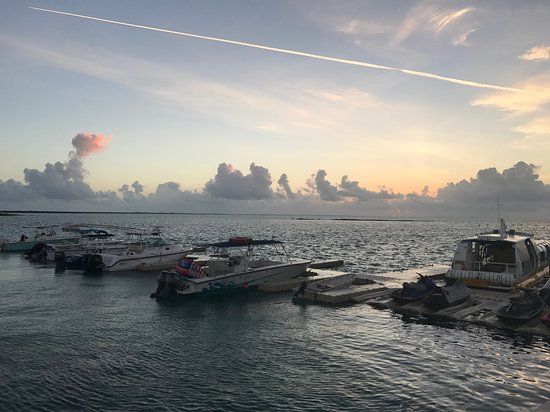 Indigenous Tours and Rentals: Sun rise over Caicos bank