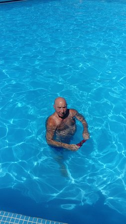 Summer Dream Hotel: Hubby enjoying a dip.