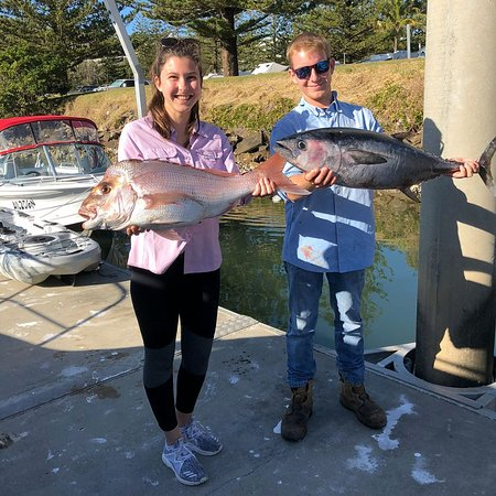 Yamba Fishing and Charters: Brianna with her snapper and John happily shows off his tuna