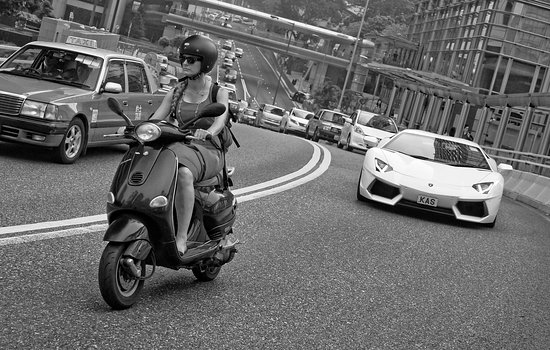 J3 Private Tours Hong Kong: Lady on a scooter vs a chap in a Lamborghini, Garden Road, Hong Kong