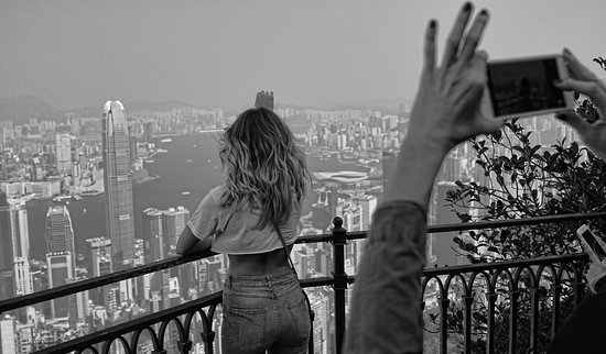 J3 Private Tours Hong Kong: One of my guests enjoying the greatest city view from my spot at the Peak, Hong Kong