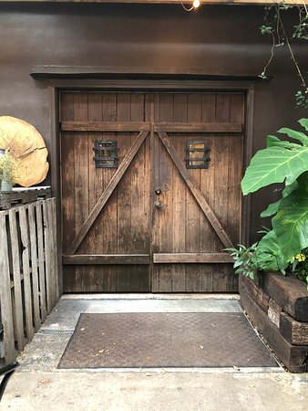 The Corkscrew Winery: The door of outside seating area. Whole place was very rustic.