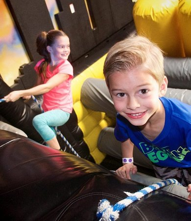 Uptown Jungle Fun Park: Our inflatable obstacle course will challenge your strength and endurance. - Mesa