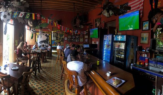La Brisa Loca Hostel : Catch the big game and grab a bite at our second floor bar.
