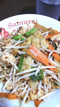 Spicy Garlic Chicken stir-fry bowl with wavy noodles  Good