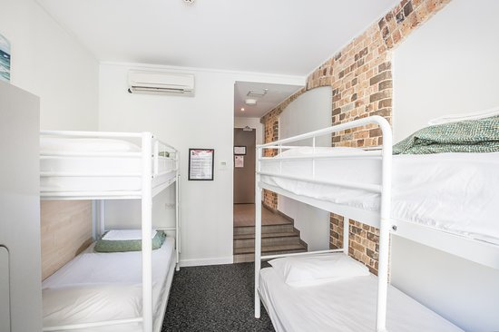 Base Backpackers: 4 Share dormitory with en suite bathroom. Own locker and linen provided.