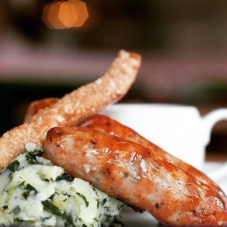 Pigsty Gloucester Road: Jolly Hog sausages with garlic and kale mash, and a cider sauce