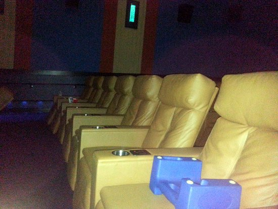 Carpentersville, IL: a row of power reclining seats with a booster chair