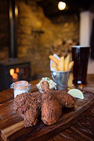Paulerspury, UK: Matt's fried chicken in front of our roaring fire