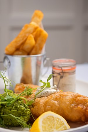 Paulerspury, UK: Classic fish and chips with real ale batter and minted mushy peas