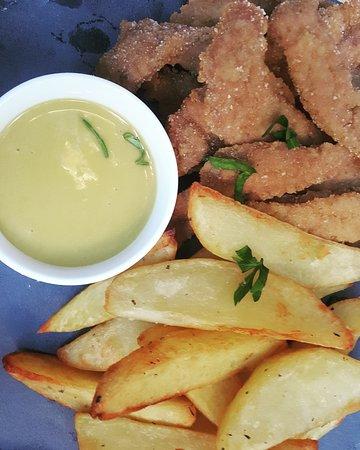 Asymmetro: Homemade Pork Schnitzel with honey and mustard sauce..