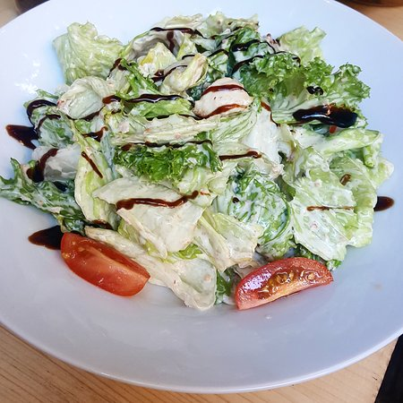 Asymmetro: Fresh mixed leaves with chicken, sun-dried tomatoes, homemade croutons and mustard dressing..