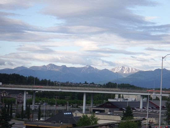 Ramada by Wyndham Anchorage: Roadside view - mountains in the distance
