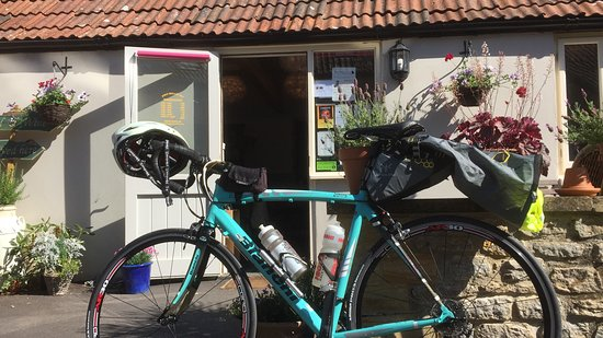 East Coker, UK: My wheels outside Village Cafe