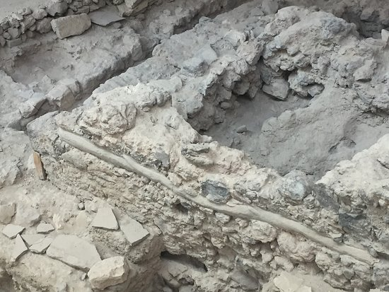 Akrotiri Archaeological Site: You can see some of the clay pipes that the village used to get rain water from the roof.