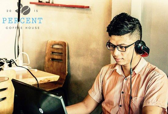 Percent Coffee House: Familiar working corner of guy designer
