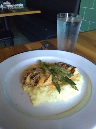 Grey's: Grilled chicken & asparagus with beer cheese and country ham dust over grits