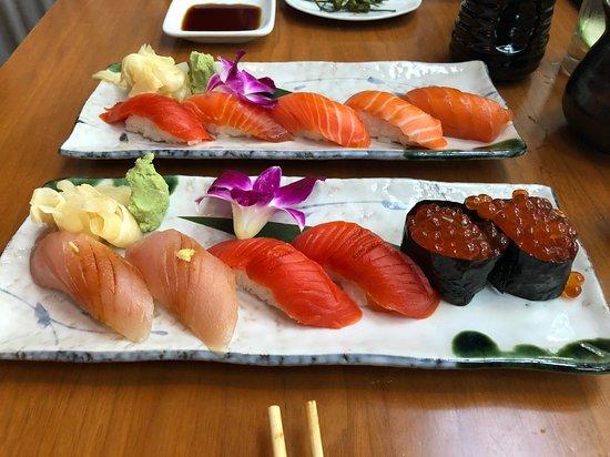 Masu Sushi: Salmon sampler in back. White tuna, salmon & ikura in front