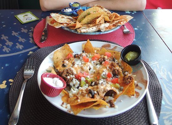 Taco Hut: Angry Nachos (front), chicken quesadillas + crispy ground beef taco (back)