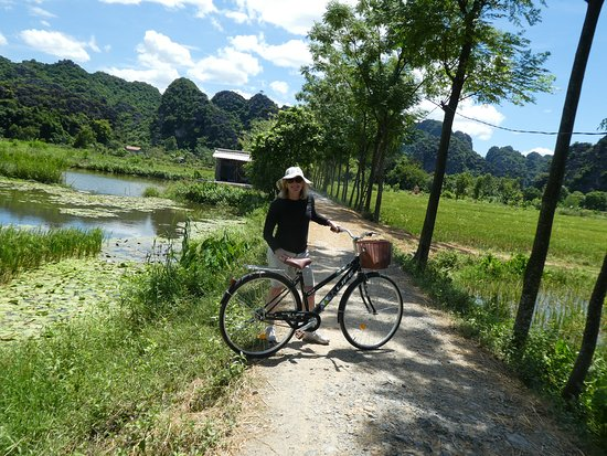 Full Day Hoa Lu Temples & Tam Coc Landscape - Small Group & Buffet Lunch: Scenic Tam Coc bike ride in the steamy summer heat.