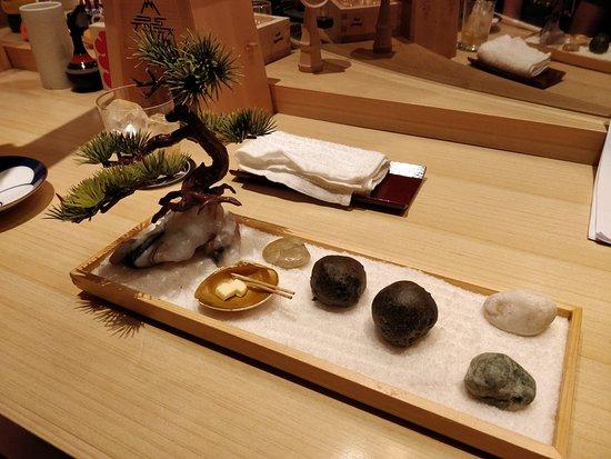 Oedo Ayatori: Black potato laying in salt.