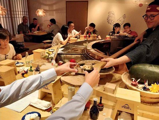 Oedo Ayatori: Mon-San sending over a dish with the rice spoon